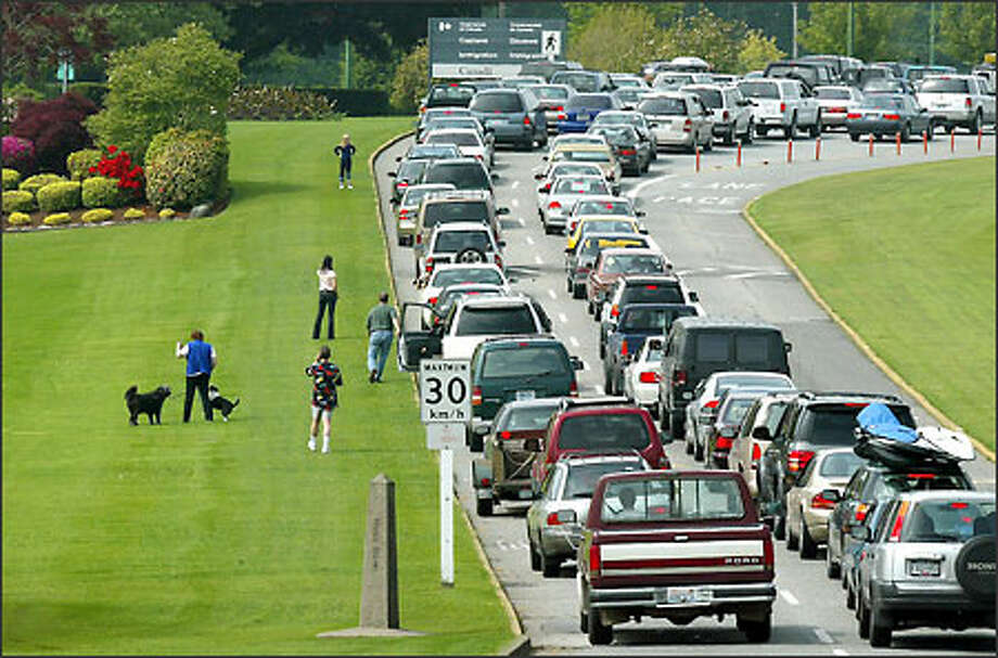 Though there can be a line at the border crossing into Canada, Customs officials say waits don't reach two hours as they have in some years. Photo: Paul Joseph Brown/Seattle Post-Intelligencer