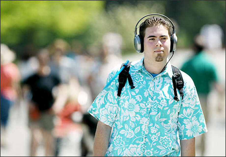 Walking around Green Lake yesterday, massage student Mike Larios, 20, listens to music he downloaded from the Internet on his new minidisc player. Photo: Paul Joseph Brown/Seattle Post-Intelligencer