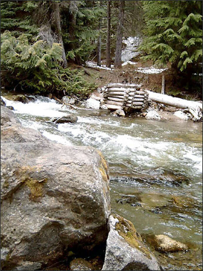 No need to worry about crossing Whitepine Creek on a rickety bridge -- it's long gone. Hikers wishing to go beyond the stream must ford it. Photo: Karen Sykes/Special To P-I