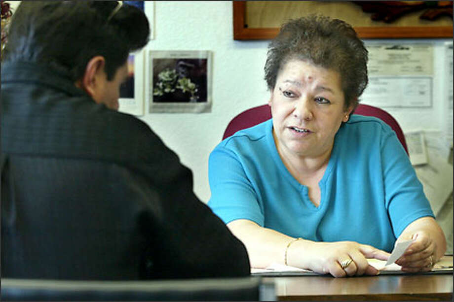 Margarita Noyola in her Wenatchee office. An injunction prevents her from dispensing immigration advice. Noyola denies any wrongdoing. Photo: Gilbert W. Arias/Seattle Post-Intelligencer
