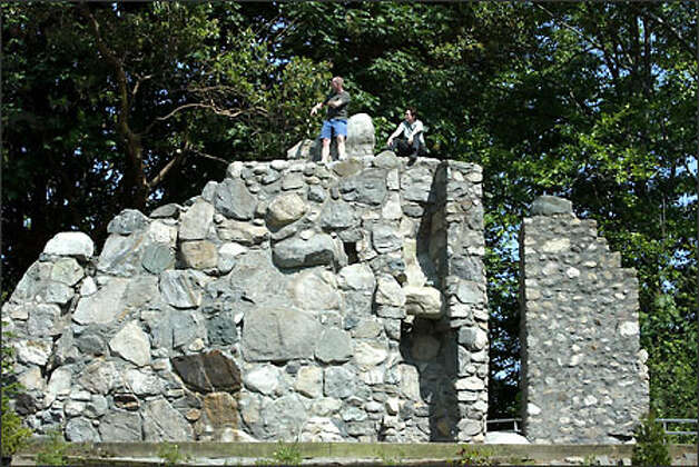 The 25-foot-high rock has been the practice ground for some of world's most accomplished mountaineers, such as Jim Whittaker, the first American to reach the top of Mount Everest. Photo: Karen Ducey/Seattle Post-Intelligencer