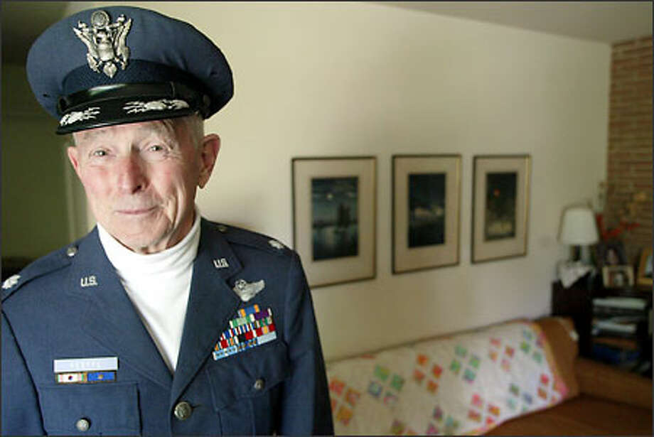 Retired Air Force Lt. Col. Jim Keeffe of Bellevue still fits into his uniform from the 1960s. Keeffe was a POW in Germany for nine months during WWII. Photo: Meryl Schenker/Seattle Post-Intelligencer
