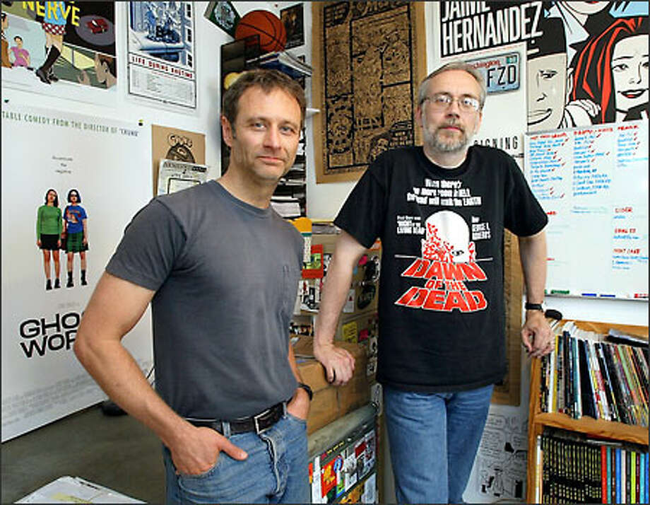 Gary Groth, left, president of Fantagraphics Books, and Kim Thompson, vice president, are just trying to get through June. Photo: Gilbert W. Arias/Seattle Post-Intelligencer