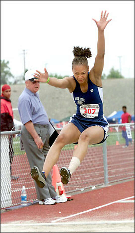 River Ridge's Lakeisha Cockrell won the 3A girls long jump with a leap of 18 feet, 8 inches. Photo: / Associated Press