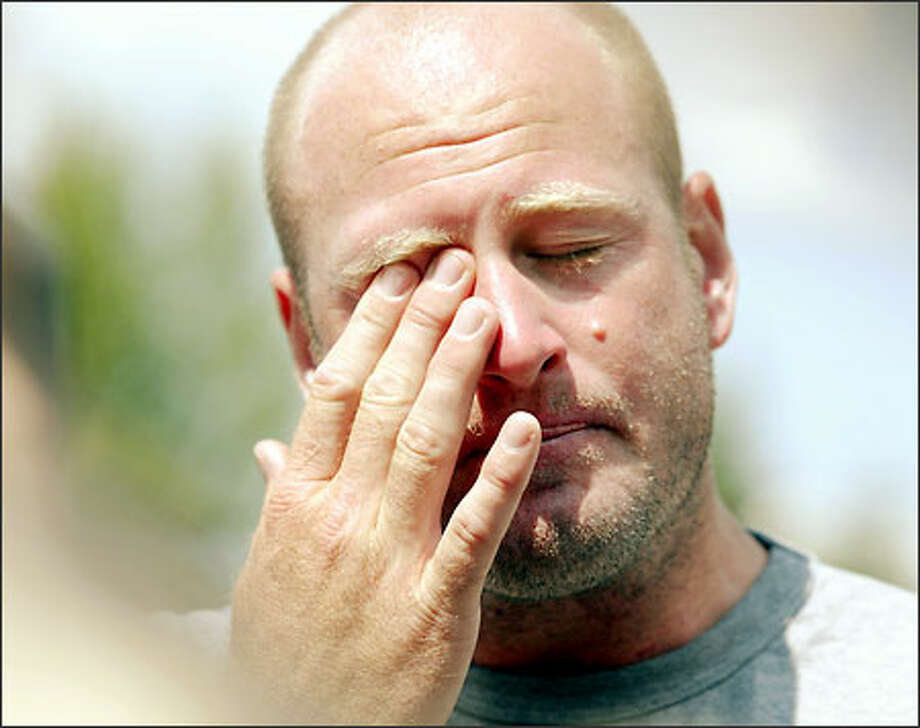 Seahawks QB Trent Dilfer wipes tears from his eyes while talking about the death of his 5-year-old son. Photo: JOHN FROSCHAUER/AP