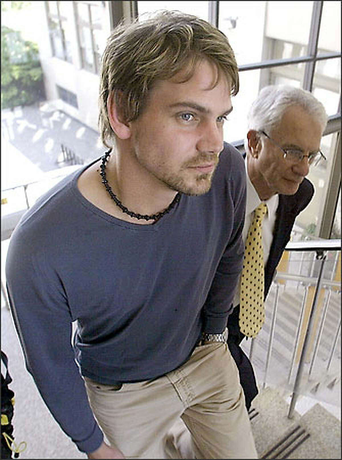 Actor Scott Hamilton Bairstow, with his attorney, Mitchell Egers, was arraigned on charges of child rape.
