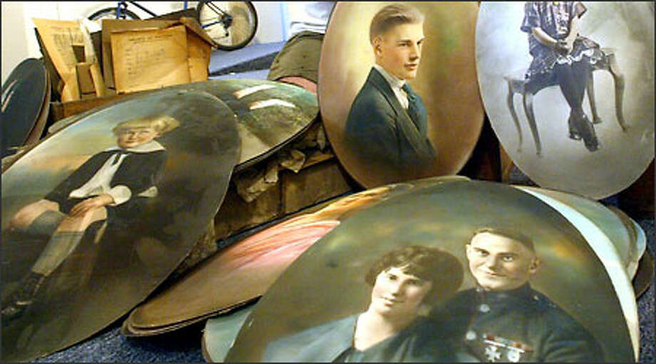 These are some of the portraits that were found in a crawl space in an office at the Bethel Christian Ministries, 2033 Second Ave., in Seattle. The church is asking for help in identifying them. Photo: Phil H. Webber/Seattle Post-Intelligencer