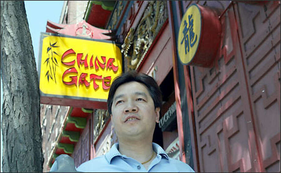 Sonny Wong, owner of China Gate at 516 Seventh Ave. S., says his restaurant has lost about 10 percent to 15 percent of its business because of SARS rumors. Photo: Phil H. Webber/Seattle Post-Intelligencer