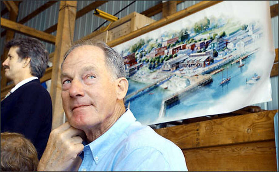 Sailor and mountaineer Jim Whittaker sits yesterday near an artist's rendition of a Northwest Maritime Center proposed for Port Townsend. Photo: / Associated Press