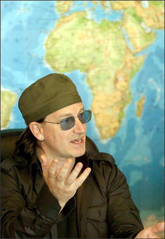 Bono, the lead singer of U2, talks about the AIDS crisis and other problems in Africa with the editorial board at the P-I. He was in town Thursday to drum up support. Photo: Scott Eklund/Seattle Post-Intelligencer