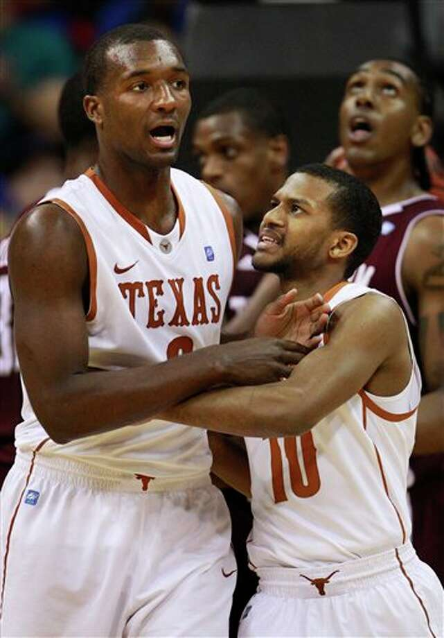 Texas' Jordan Hamilton (left) is congratulated by teammate Jai Lucas during Friday's win over Texas A&M. Hamilton and his teammates aren't bothered by a perceived snub. (ORLIN WAGNER/ASSOCIATED PRESS)