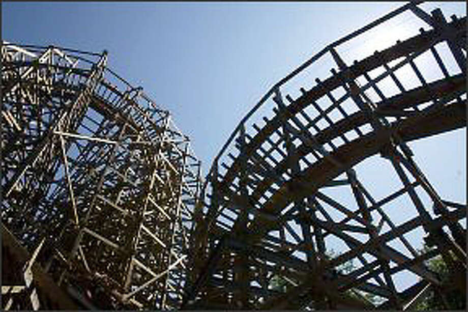 The TimberHawk, a wooden roller coaster at Wild Waves and Enchanged Village, is a blast from the past. Photo: Karen Ducey/Seattle Post-Intelligencer