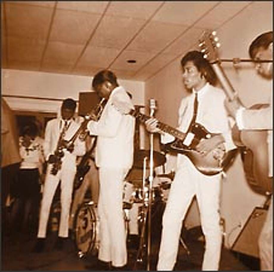 Jimi Hendrix, second from right, performs with the Isley Brothers in 1964. Photo: P-I File
