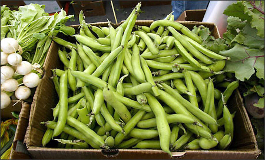 A box of fava beans from the Alvarez Farms in Mabton awaits customers at the Columbia City Farmers Market. Photo: Grant M. Haller/Seattle Post-Intelligencer