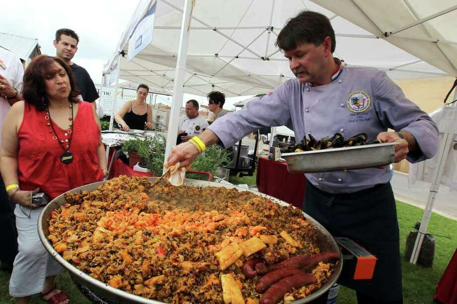 Chef Tim McCarty of Minnesota puts finishing touches on his Yankee Paella, which included squash, at the Paella Challenge at the Pearl Brewery, on Sunday, March 13, 2011. Photo: Jennifer Whitney/Special To The Express-News / special to the Express-News