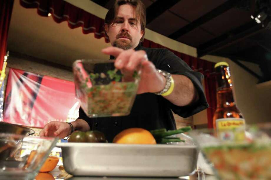 Chef Jeff Balfour of the restaurant Citrus adds to his trio of ceviches during the Ceviche Samba contest, part of the Paella Challenge at the Pearl Brewery, on Sunday, March 13, 2011. Balfour won the Paella Challenge. Photo: Jennifer Whitney/Special To The Express-News / special to the Express-News