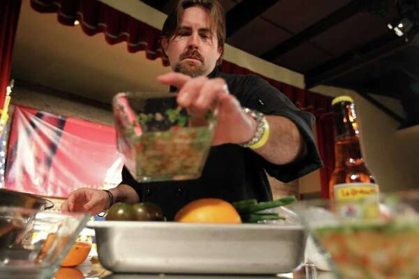 Chef Jeff Balfour of the restaurant Citrus adds to his trio of ceviches during the Ceviche Samba contest, part of the Paella Challenge at the Pearl Brewery, on Sunday, March 13, 2011. Balfour won the Paella Challenge.