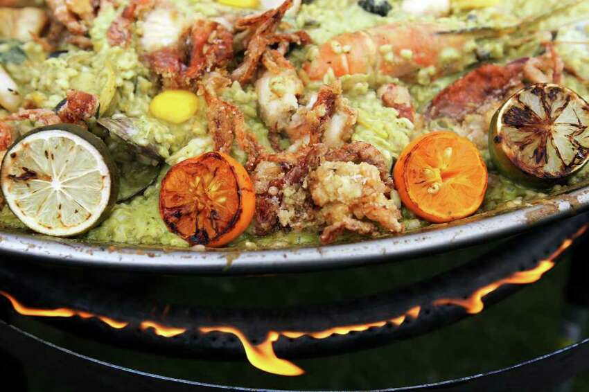 Grand Hyatt chef Jeffrey Axell's Thai green curry paella with rangpur limes, quail eggs, sea urchin, soft-shell crab and tiger prawns simmers over the flame at the 2011 Paella Challenge.