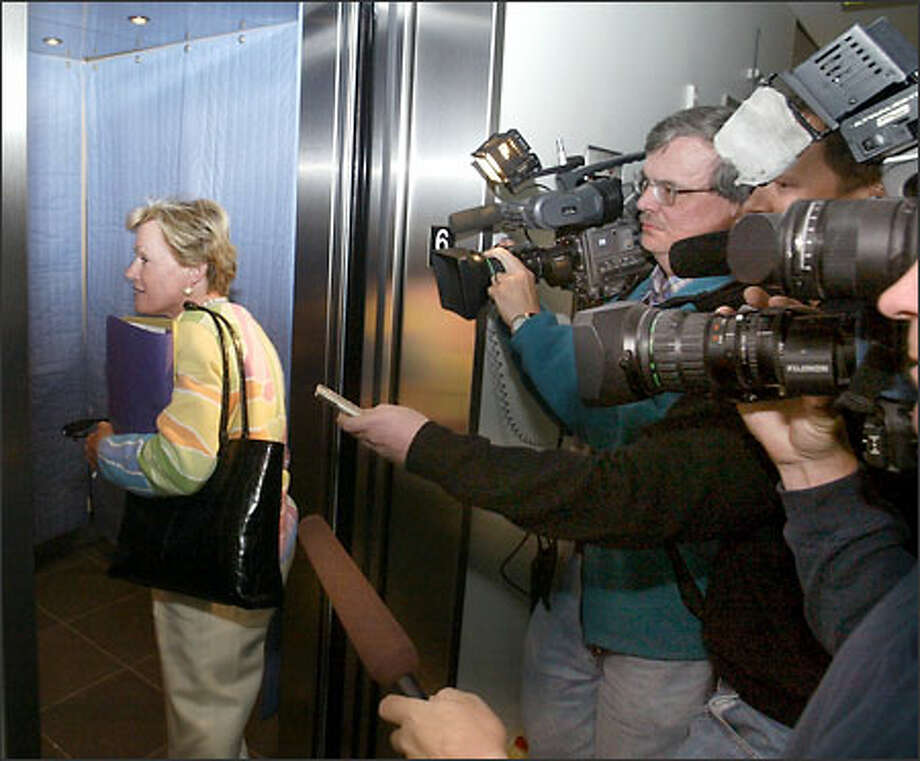 Athletic director Barbara Hedges leaves a meeting where Rick Neuheisel's future was discussed. Hedges declined to comment. Photo: Scott Eklund/Seattle Post-Intelligencer