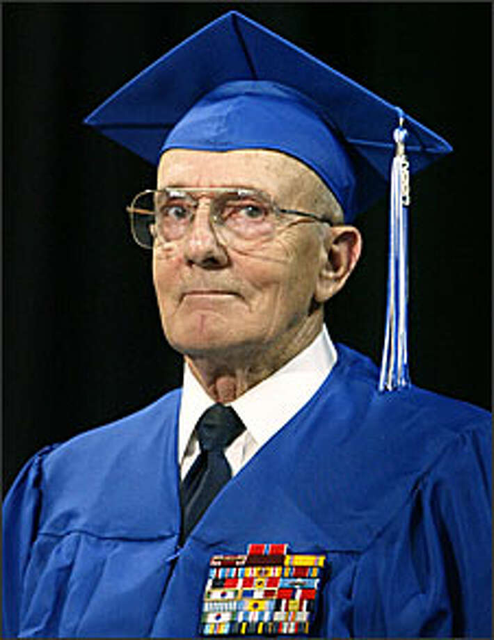 A military career took him away from high school in 1945, but last night, Robert Anderson at last received his diploma with Bothell's class of 2003. Photo: Karen Ducey/P-I