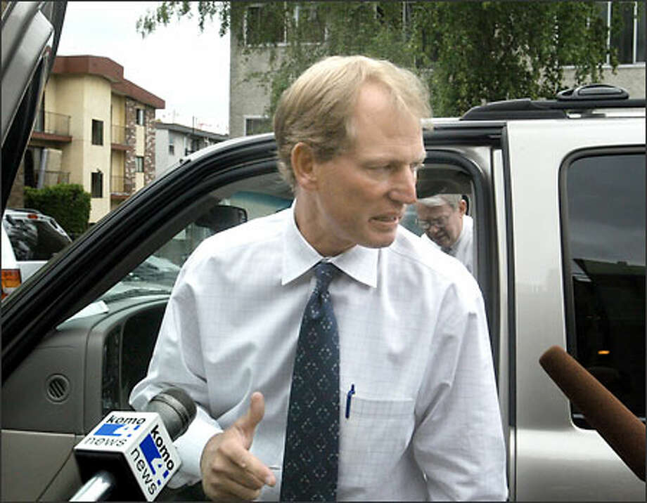 Rick Neuheisel talks to the media after leaving a meeting on Tuesday when he was informed of his termination. Photo: Scott Eklund/Seattle Post-Intelligencer