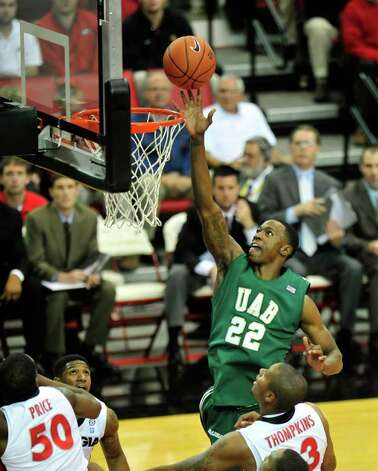 UAB forward Cameron Moore (22) makes a layup against Georgia during an NCAA college basketball game on Friday, Dec. 3, 2010, at Stegeman Coliseum in Athens, Ga. (AP Photo/Athens Banner-Herald, Richard Hamm) ** MANDATORY CREDIT; MAGAZINES OUT; NO SALES; TV OUT ** Photo: AP