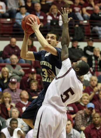 Northern Colorado guard Paul Garnica(3) goes up against Montana guard Will Cherry(5) during the first half of an NCAA college basketball game in Missoula, Mont. on Saturday, Feb. 12, 2011. Photo: AP