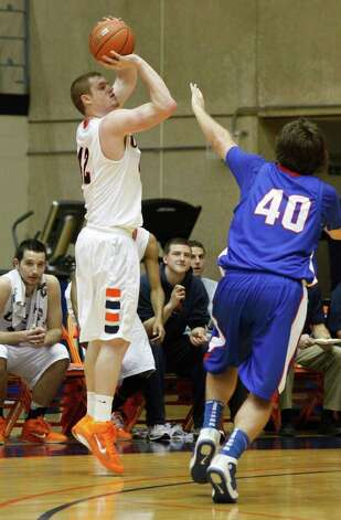 SPORTS; BKC OK PANHANDLE UTSA JMS; 01/24/11; Freshman forward Tyler Wood, of San Antonio, puts up and hits one of several 3-point shots over Aggie forward Jared Messer as the UTSA men's basketball hosted Oklahoma Panhandle in a non-conference game Monday, January 24, 2011 at the Convocation Center at UTSA in San Antonio. ( Photo by J. Michael Short / SPECIAL ) Photo: J. Michael Short, SPECIAL TO THE EXPRESS-NEWS / THE SAN ANTONIO EXPRESS-NEWS
