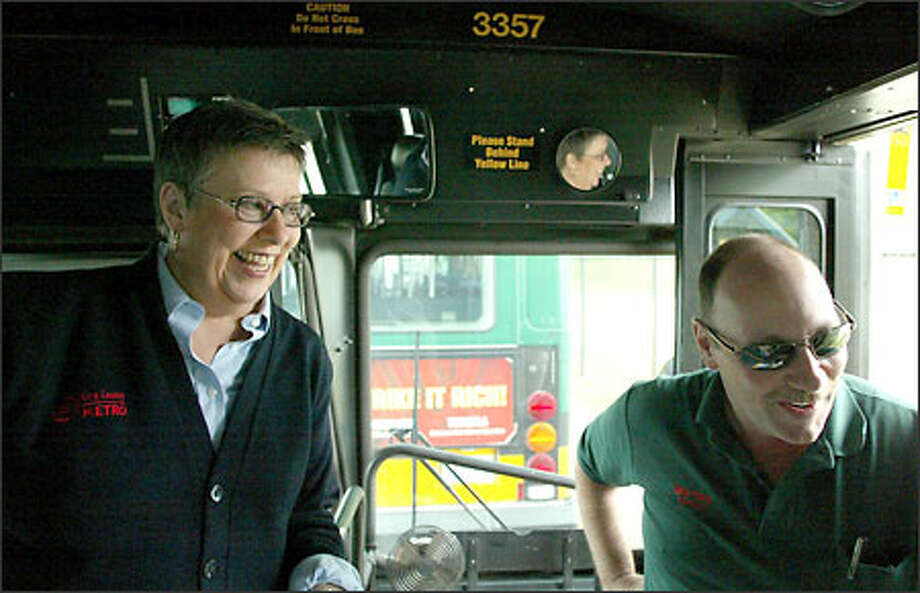 Metro's operator of the year, Judi Fisher, enjoys a break with fellow driver Richard Jensen on Tuesday. Fisher has been driving buses in Seattle for 29 years. Photo: David Bitton/Seattle Post-Intelligencer