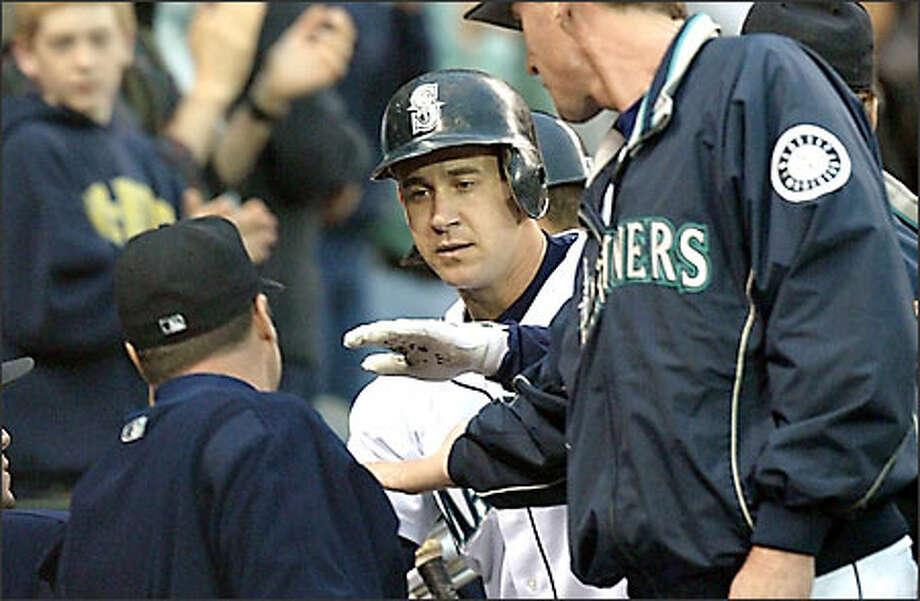 Bret Boone is congratulated after hitting a home run. Photo: Scott Eklund/Seattle Post-Intelligencer