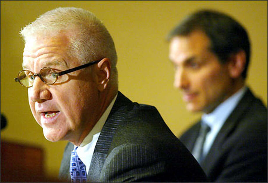 Jerry Crawford, left, and Bob Sulkin, attorneys for ousted UW football coach Rick Neuheisel, discuss a possible appeal of his firing during a news conference Friday. Photo: Mike Urban/Seattle Post-Intelligencer