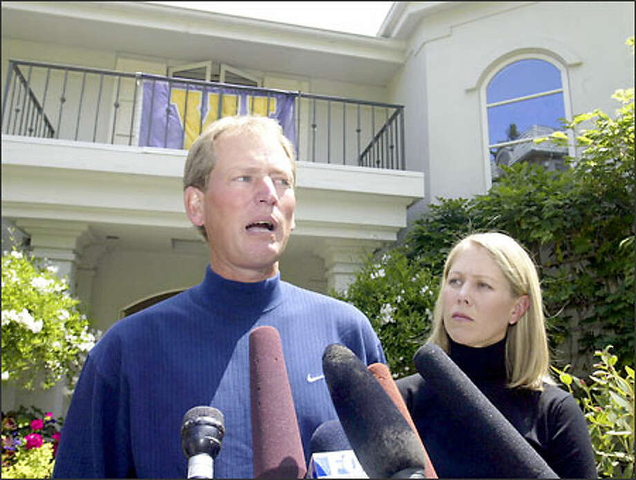 Rick Neuheisel, shown here on June 16, 2003 with his wife Susan, told reporters that day he still wanted to coach the Huskies. Photo: / Associated Press