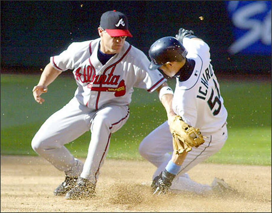 Braves second baseman Marcus Giles applies the tag late as Seattle's Ichiro Suzuki steals second base. Photo: Jim Bryant/Seattle Post-Intelligencer