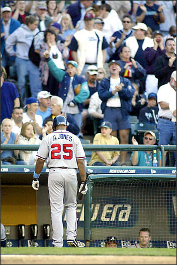 Atlanta's Andruw Jones trudges back to the dugout after fanning against Arthur Rhodes for the second out in the ninth inning. Photo: Jim Bryant/Seattle Post-Intelligencer