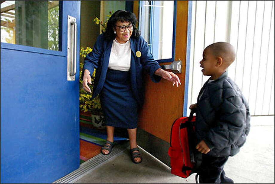 "Leahe ""Mom"" Wilson, who runs the family support center at The New School @ South Shore, greets Talon Davis, a 4-year-old pre-kindergarten student, at the door. Photo: Paul Joseph Brown/Seattle Post-Intelligencer"