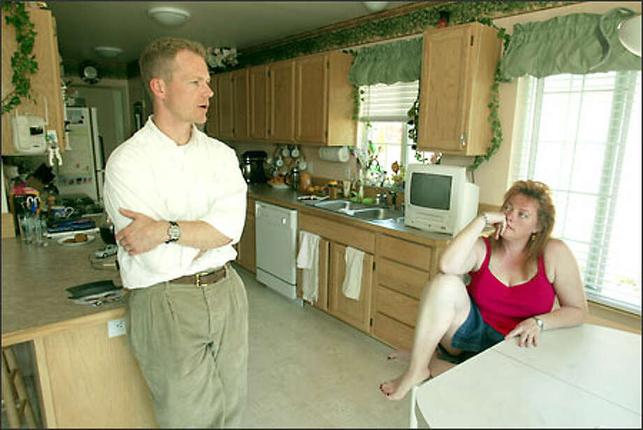 Brent and Shauna Kelln talk about the distribution of power in the family since he came home from almost 10 months aboard the USS Abraham Lincoln before and during the war against Iraq. Photo: Grant M. Haller/Seattle Post-Intelligencer