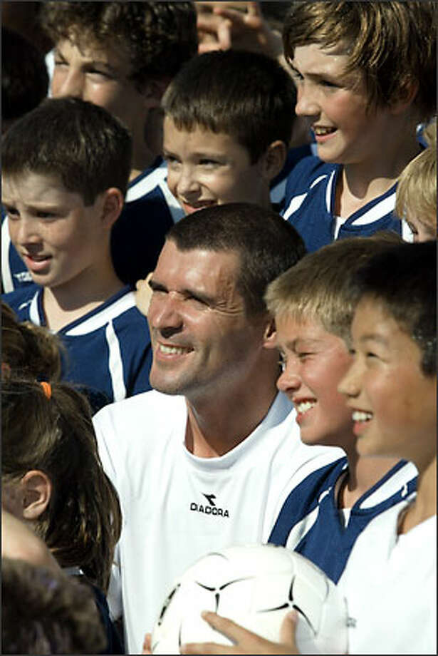 Manchester United captain Roy Keane was in Seattle yesterday to give soccer tips to fledgling players. Photo: David Bitton/Seattle Post-Intelligencer
