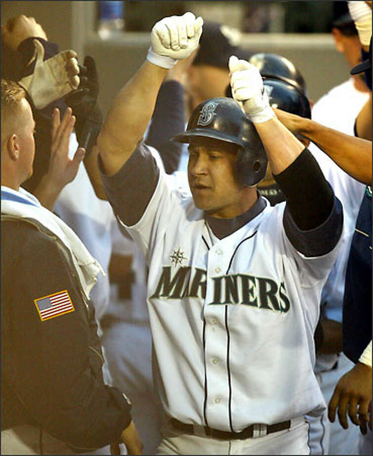 Bret Boone's grand slam, his 19th HR, helped Seattle earn its second consecutive win over defending World Series champion Anaheim. Photo: Gilbert W. Arias/Seattle Post-Intelligencer