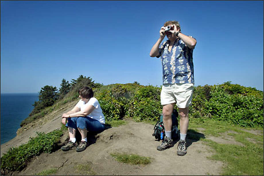 Sandra and John Lund enjoy the view at Cape Falcon, where sea lions are often spotted. Oregon's many beautiful coastal trails are a hiker's dream. Photo: Gilbert W. Arias/Seattle Post-Intelligencer