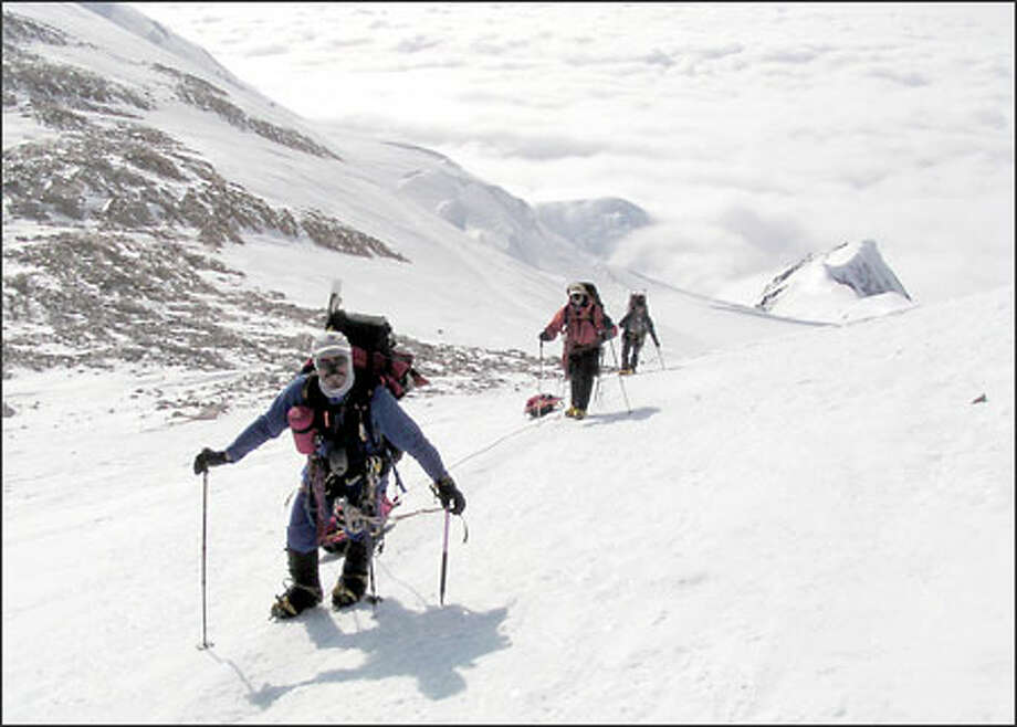 Erden Eruc, left, Jeremy Cranford and Eddie Espinosa during a climb of Denali in Alaska. Eruc plans a round-the-world cycling, rowing and climbing trip. Photo: Courtesy Erden Eruc
