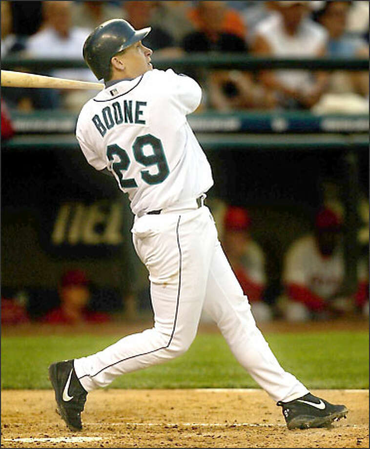 Bret Boone, shown belting a grand slam in Tuesday's 8-4 win over the Angels, doesn't consider himself a home-run hitter. Photo: Gilbert W. Arias/Seattle Post-Intelligencer