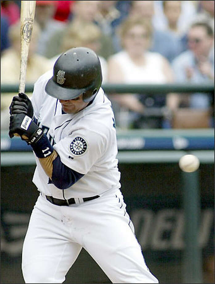Edgar Martinez recoils after being hit by a pitch in the fourth inning. Photo: TED S. WARREN/AP