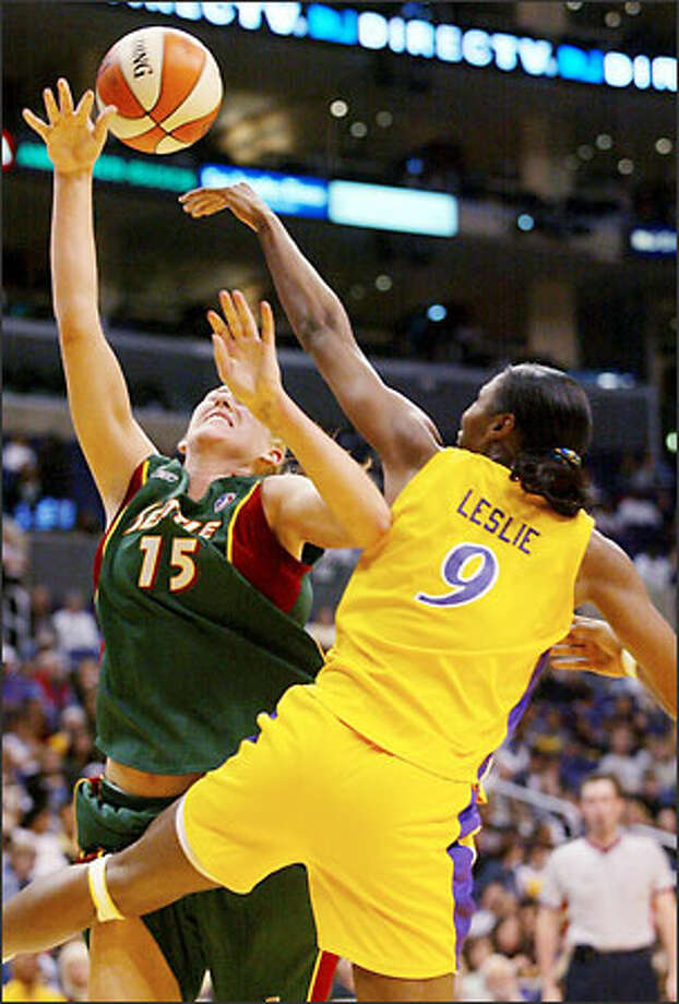 Sparks center Lisa Leslie blocks Storm forward Lauren Jackson's shot, but is called for a technical foul on the play. Photo: DANNY MOLOSHOK/AP