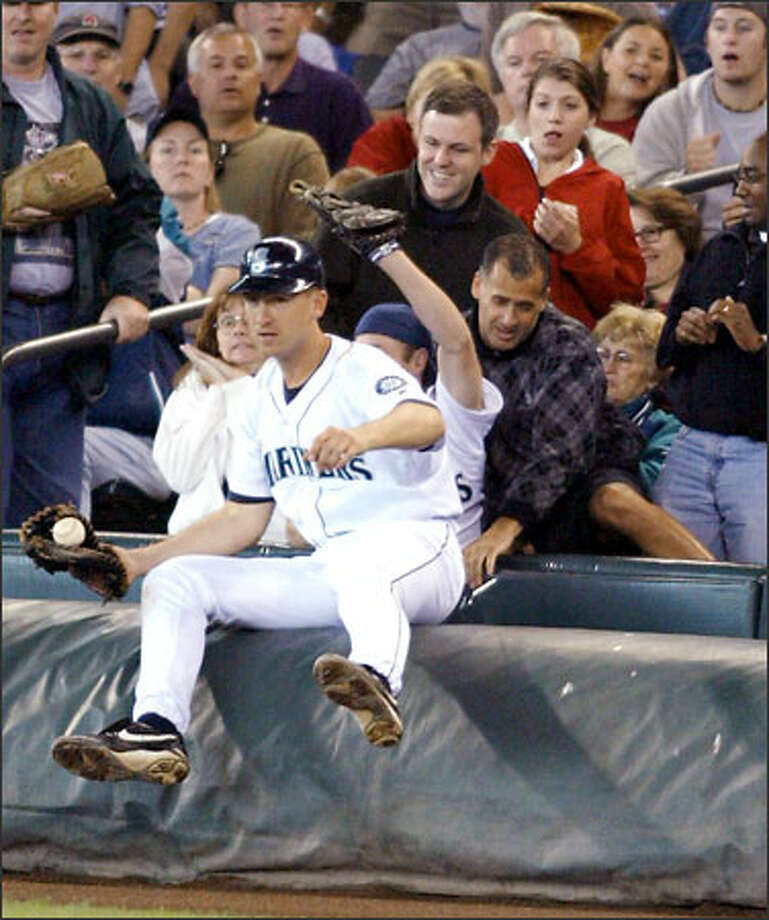 John Olerud has to contend with fans when chasing foul pops, but other plays are tougher. Photo: / Associated Press