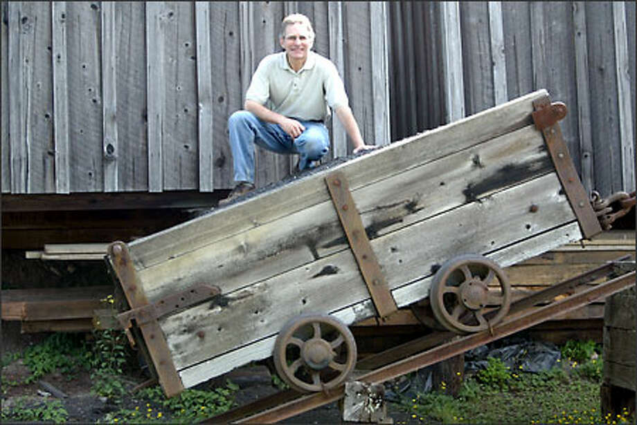 William Kombol of the Palmer Coking Coal Co. shows a reconstructed 2-ton coal car on display at the Black Diamond Historical Museum Photo: Karen Ducey/Seattle Post-Intelligencer