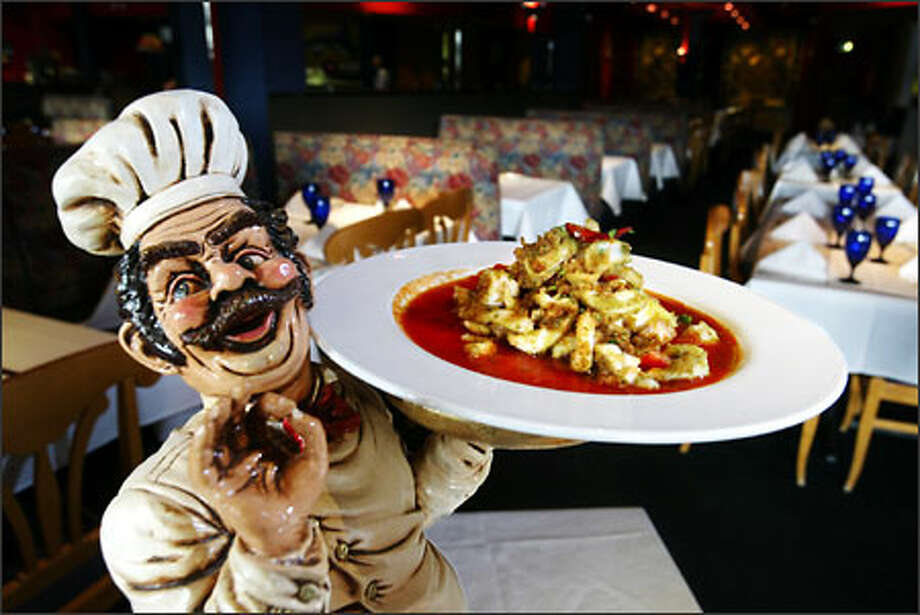 This statue, holding Calamari in Umido (herb-breaded squid with garlic, lemon and tomato) greets guests at Isabella Ristorante downtown. Photo: Scott Eklund/Seattle Post-Intelligencer