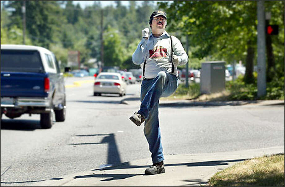 Daniel Pickard drums up business for Redmond's Blazing Bagels with his dances, complete with air guitar. Photo: Dan DeLong/Seattle Post-Intelligencer