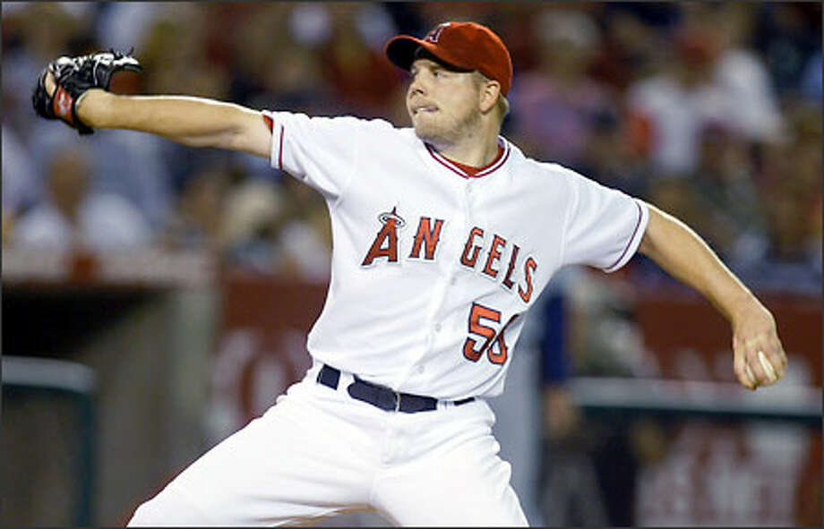 Angels starter Jarrod Washburn left the game with a 5-4 lead in the sixth inning, but reliever Ben Weber gave up four runs as Seattle went ahead 8-5. Photo: DANNY MOLOSHOK/AP