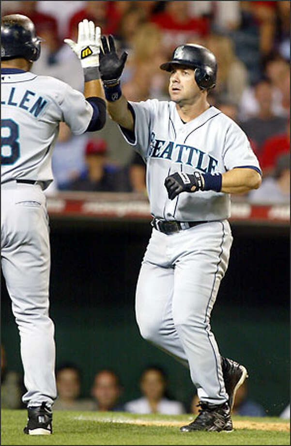 Edgar Martinez's seventh-inning home run moved him past Ken Griffey Jr. atop Seattle's RBI list. Photo: DANNY MOLOSHOK/AP