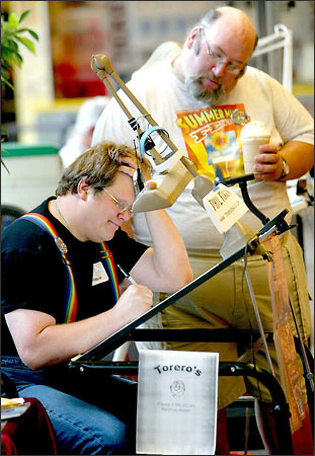 John Reiher, right, watches Phil Foglio working on a comic book. Foglio was one of 27 cartoonists who participated in the Cartoonists Northwest challenge at the Broadway Market to draw a comic book in 24 hours. Photo: Grant M. Haller/Seattle Post-Intelligencer